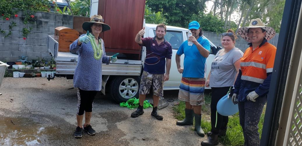 Helping a wheelchair using client during the Townsville floods
